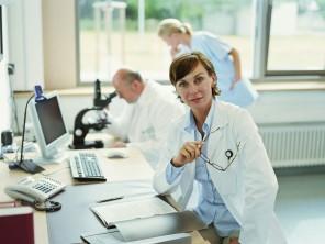 Female doctor sitting in office, portrait